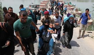 Displaced Iraqis from Ramadi cross the Bzebiz bridge fleeing fighting in Ramadi, 65 km west of Baghdad, Iraq, Wednesday, May 20, 2015. Thousands of displaced people fleeing violence in nearby Anbar province poured into Baghdad province on Wednesday after central government granted them conditional entry, said a provincial official.  (Associated Press) ** FILE **