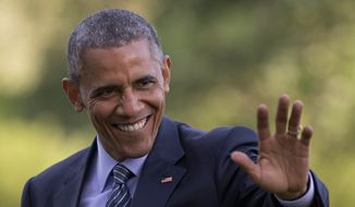 President Barack Obama waves as he walks across the South Lawn to the White House from Marine One, Wednesday, May 20, 2015, in Washington, as he returns from Connecticut where he delivered the commencement address at the United States Coast Guard Academy and attended a Democratic National Committee event. (AP Photo/Carolyn Kaster)