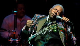 In this Feb. 16, 2007, file photo, B.B. King performs at the Wicomico Youth and Civic Center, in Salisbury, Md. The body of blues legend B.B. King  will be flown on Wednesday, May 20, 2015, to Memphis, Tennessee, the place where a young King won the nickname Beale Street Blues Boy, then will return to the Mississippi Delta where his life and career began. (Matthew S. Gunby/The Daily Times via AP)