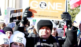 The Radiance Foundation's website, toomanyaborted.com, is cited in a poster held at a March for Life. (Image courtesy of The Radiance Foundation.)