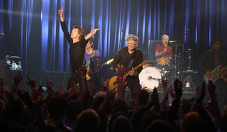 Mick Jagger and the Rolling Stones perform at the Fonda Theatre in Los Angeles, Wednesday, May 20, 2015. The Rolling Stones ripped through the intimate Fonda Theatre Wednesday with enough energy to fuel their entire 15-city North American tour. (Jane Bouquet/The Rolling Stones via AP)