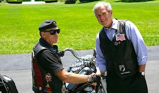 Rolling Thunder founder Artie Muller has brought attention to veterans' issues for years; here he is greeted at the White House by President George W. Bush in 2008. (white house)