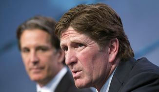 Toronto Maple Leafs new head coach Mike Babcock, right, speaks to reporters with team president Brendan Shanahan during an NHL hockey press conference in Toronto, Thursday, May 21, 2015.  Babcock spent the last 10 seasons with the Detroit Red Wings, where he won the Stanley Cup in 2008. (Darren Calabrese/The Canadian Press via AP) MANDATORY CREDIT