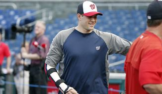 Washington Nationals relief pitcher Craig Stammen (35) wears a brace on his arm before an interleague baseball game against the New York Yankees at Nationals Park, Tuesday, May 19, 2015, in Washington. (AP Photo/Alex Brandon)