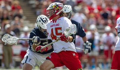 May 9, 2015: Maryland Terrapins Bryan Cole (45) fights off a Yale defender during the NCAA Men's Division I Championship first round lacrosse game between Yale Bulldogs versus Maryland Terrapins at Capital One Bank Field at Byrd Stadium in College Park, MD.  (Icon Sportswire via AP Images)