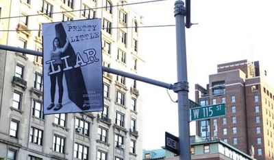 """Posters calling Emma Sulkowicz a """"pretty little liar"""" briefly decorated the Manhattan neighborhood surrounding Columbia University on Wednesday, after the alleged rape victim graduated with her mattress in tow. (Twitter/@fakerape)"""