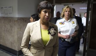 Washington Mayor Muriel Bowser, left, and Police Chief Cathy Lanier, arrives for a news conference in Washington, Thursday, May 21, 2015, to discuss  the mysterious slayings of a wealthy Washington family and their housekeeper.  (AP Photo/Cliff Owen)