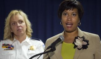 Washington Mayor Muriel Bowser, right, and Police Chief Cathy Lanier, participate in a news conference in Washington, Thursday, May 21, 2015, to discuss the investigation into the mysterious slayings of a wealthy Washington family and their housekeeper. Lanier said investigators believe a suspect in the slayings is in the Brooklyn area of New York City.  (AP Photo/Cliff Owen)