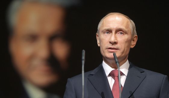 Russian Prime Minister Vladimir Putin speaks at a concert marking the 80th birthday anniversary of Russia's first president, Boris Yeltsin, in Moscow, Tuesday, Feb. 1 , 2011. (AP Photo/RIA Novosti, Alexei Druzhinin, Pool)