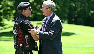Rolling Thunder founder Artie Muller with President George W. Bush in 2008 (White House image)