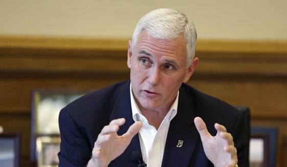 Indiana Gov. Mike Pence discusses the legislative session that ended the day before during a news conference at the Statehouse in Indianapolis, in this April 30, 2015, file photo. (AP Photo/Michael Conroy)
