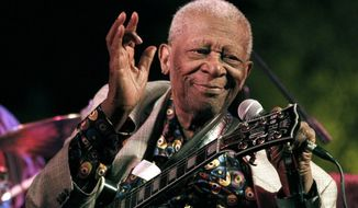 Then 86-year-old B.B. King thrills a crowd of several hundred people at the annual B.B. King Homecoming, a free concert on the grounds of an old cotton gin where he worked as a teenager many years ago, in Indianola, Miss., in this Aug. 22, 2012, file photo. (AP Photo/Rogelio V. Solis, File)