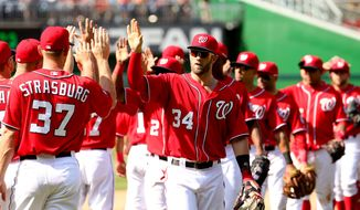 Washington Nationals' Bryce Harper celebrates with teammates following a baseball game against the Philadelphia Phillies, Sunday, May 24, 2015, in Washington. The Nationals won 4-1. (AP Photo/Andrew Harnik)