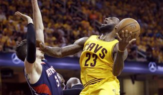 Cleveland Cavaliers' LeBron James (23) goes up for a shot against Atlanta Hawks' Mike Muscala during the second half in Game 3 of the Eastern Conference finals of the NBA basketball playoffs Sunday, May 24, 2015, in Cleveland. (AP Photo/Tony Dejak)