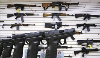 Assault weapons and handguns are seen for sale at Capitol City Arms Supply in Springfield, Illinois. Residents of Arlington, Virginia, are trying to bully Marine Corps veteran James Gates, 28, from opening a gun shop in their neighborhood. (Associated Press)