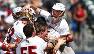 Denver goalie Ryan LaPlante (10) is lifted by teammates after their 10-5 win over Maryland in the NCAA Division I men's lacrosse championship, Saturday, May 25, 2015, Philadelphia. (AP Photo/Rich Schultz)