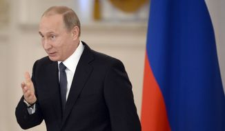 Russian President Vladimir Putin has sought to downplay the effects of U.S. and European sanctions on his country's economy, asserting that Russia has managed to survive the economic assault from the West. (Associated Press)