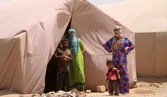 Displaced Iraqi civilians from Ramadi stand in a refugee camp west of Baghdad. The Islamic State's rout of Ramadi exposed more than the Iraqi army's lack of will to fight. After months of U.S. and coalition airstrikes on Islamic State targets, U.S. surveillance and intelligence collection, and with senior American officers advising Iraqis at a joint command center, the battlefield outcome still was no better than the rout of Mosul. (Associated Press)