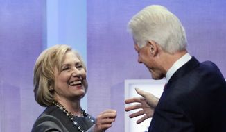 Former Secretary of State Hillary Rodham Clinton is welcomed to the stage by her husband, former President Bill Clinton, at the Clinton Global Initiative in New York in this Sept. 22, 2014, file photo. (AP Photo/Mark Lennihan, File) ** FILE **