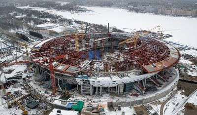 The not-yet completed Zenit Stadium  will host 2018 World Cup matches in St.Petersburg, Russia.  Swiss federal prosecutors opened criminal proceedings related to the awarding of the 2018 and 2022 World Cups. (Associated Press)