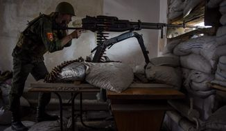 A Russia-backed rebel take aim on the outskirts of Donetsk, eastern Ukraine. The situation in eastern Ukraine has remained tense and skirmishes between Ukrainian forces and Russia-backed separatists have continued. Vice President Joseph R. Biden said that ending the Russia-Ukraine conflict is a key test of U.S. and European leadership. (Associated Press photographs)