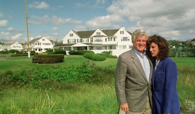 Sen. Edward M. Kennedy, D-Mass., left, stands with his wife Victoria Reggie Kennedy in front of houses inside the Kennedy compound in Hyannis Port, Mass., in this Sept. 13, 1992 file photo. Ted Kennedy, has died after battling a brain tumor his family announced early Wednesday Aug. 26, 2009. (AP Photo/Susan Walsh)