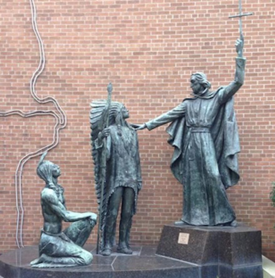 SLU removes 'racist' statue of Catholic priest