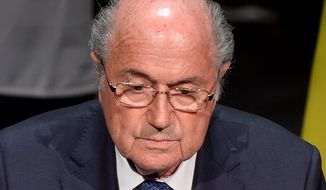 FIFA President Sepp Blatter has sat atop soccer's ruling body for five terms and faces a tough vote Friday to keep his position. (Associated Press)