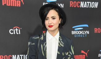 "Demi Lovato arrives at the Roc Nation Pre-Grammy Brunch at RocNation Offices in Beverly Hills, Calif., in this Feb. 7, 2015, file photo. Lovato is sharing her personal story and encouraging others to do the same through ""Be Vocal: Speak Up For Mental Health,"" an initiative launched Thursday, May 28, 2015, by a pharmaceutical company, the National Alliance on Mental Illness and other mental-health advocacy groups. (Photo by Rob Latour/Invision/AP, File)"