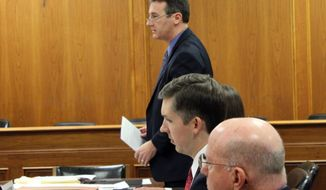 """Attorney David Niose, top, representing the American Humanist Association, addresses the court as he presents an argument in a family's lawsuit against the Matawan-Aberdeen Regional School District over the Pledge of Allegiance, Wednesday, Nov. 19, 2014, in Monmouth County Superior Court in Freehold, N.J. The humanist group says including the phrase """"under God"""" in the pledge violates the state constitution and marginalizes atheist and humanist students.   (AP Photo/The Star-Ledger, Ashley Peskoe, Pool)"""