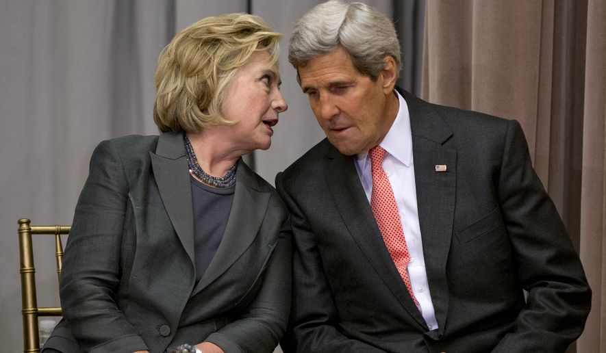 Secretary of State John Kerry speaks with former Secretary of State Hillary Rodham Clinton during the groundbreaking ceremony for the U.S. Diplomacy Center, Wednesday, Sept. 3, 2014, at the State Department in Washington. Kerry hosted five of his predecessors in a rare public reunion for the groundbreaking of a museum commemorating the achievements of American statesmanship. (AP Photo/Carolyn Kaster)