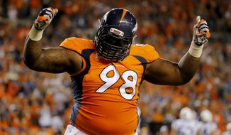 FILE - In this Sept. 7, 2014, file photo, Denver Broncos defensive tackle Terrance Knighton celebrates a stop during the second half of an NFL football game against the Indianapolis Colts in Denver. The big debate in the Broncos locker room is whether or not 350-pound nose tackle Knighton can dunk a basketball. (AP Photo/Jack Dempsey, File)