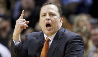 FILE- In htis Jan. 29, 2012, file photo, Chicago Bulls head coach Tom Thibodeau gestures during the first half of an NBA basketball game against the Miami Heat in Miami. The Bulls fired Thibodeau on Thursday, May 28, 2015. (AP Photo/Wilfredo Lee, File)