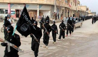 This undated file image posted on a militant website on Tuesday, Jan. 14, 2014, which has been verified and is consistent with other AP reporting, shows fighters from the al Qaeda-linked Islamic State of Iraq and the Levant (ISIL), now called the Islamic State group, marching in Raqqa, Syria.  **FILE**