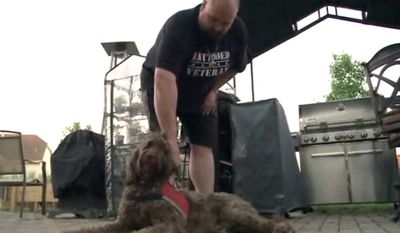 Garrett Loughran, 32, and his 5-year-old labradoodle, Hershey, were denied service on Sunday at Houlihan's in the Chicago suburb of Algonquin. (WGN-TV)