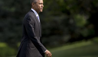President Barack Obama walks across the South Lawn of the White House from Marine One, Thursday, May 28, 2015, in Washington, as he arrives from Miami where the he visited the National Hurricane Center and the Shrine of Our Lady of Charity to pay his respects to the Cuban-American diaspora that worship there. (AP Photo/Carolyn Kaster)