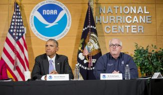 President Barack Obama, with Federal Emergency Management Agency (FEMA) Administrator Craig Fugate, participate in a briefing at the National Hurricane Center in Miami, Thursday, May 28, 2015, to draw attention to preparedness in advance of the annual storm season that formally begins June 1. (AP Photo/Pablo Martinez Monsivais)