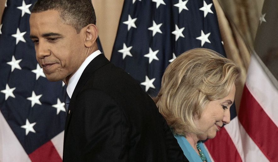 President Barack Obama passes then-Secretary of State Hillary Clinton before delivering a policy address on events in the Middle East at the State Department in Washington on May 19, 2011. (Associated Press) **FILE**