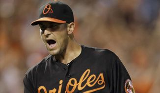 Baltimore Orioles relief pitcher Darren O'Day reacts after ending the ninth inning of a baseball game against the Tampa Bay Rays, Friday, May 29, 2015, in Baltimore. Baltimore won 2-1. (AP Photo/Patrick Semansky)