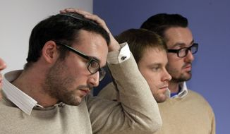 "Chaim Levin, left, and Michael Ferguson, right, with his partner Seth Anderson, listen to a a news conference, in New York, Tuesday, Nov. 27, 2012. Levin, of the Crown Heights neighborhood of Brooklyn. N.Y., and Ferguson, of Salt Lake City, are two of four gay men accusing a New Jersey organization of selling ""conversion therapy"" services promising to make them straight. Instead, they told the news conference that they were subjected to humiliations, including having to strip naked, or taking a baseball bat to effigies of their mothers. (AP Photo/Richard Drew) ** FILE **"