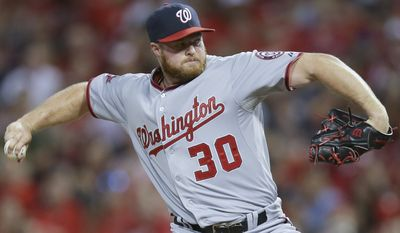 Washington Nationals relief pitcher Aaron Barrett throws in the sixth inning of a baseball game against the Cincinnati Reds, Friday, May 29, 2015, in Cincinnati. (AP Photo/John Minchillo)