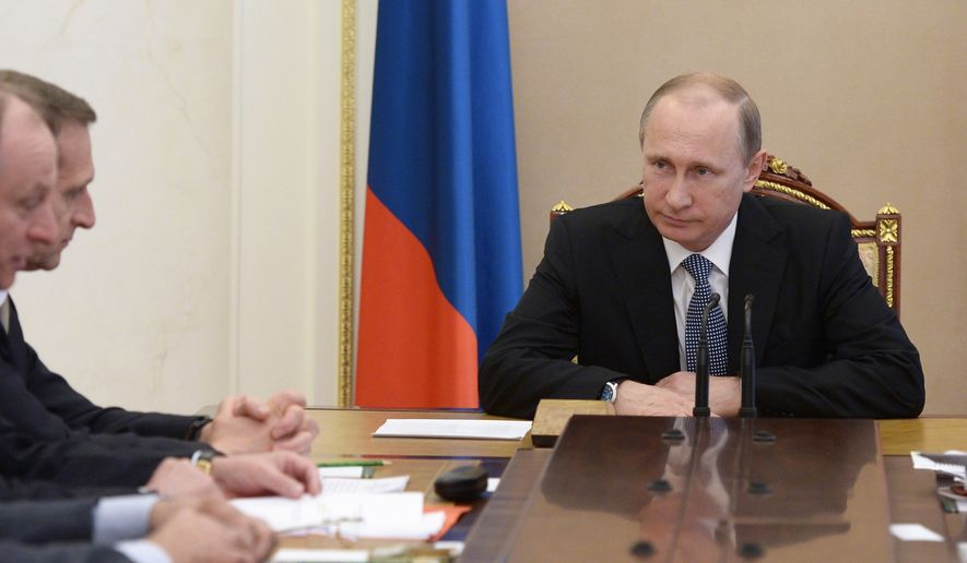 """Russian President Vladimir Putin chairs a meeting of the Security Council in the Kremlin in Moscow, Russia, Friday, May 29, 2015.  Russian President Vladimir Putin signed a decree on Thursday to make losses of Russian troops who are on """"special operations"""" in peacetime,  a state secret. (Alexei Nikolsky/RIA-Novosti, Kremlin Pool Photo via AP)"""