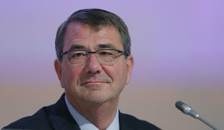 """U.S. Secretary of Defense Ashton Carter delivers his speech about """"The United States and Challenges to Asia-Pacific Security"""" during the 14th International Institute for Strategic Studies Shangri-la Dialogue, or IISS, Asia Security Summit, Saturday, May 30, 2015, in Singapore. (AP Photo/Wong Maye-E)"""