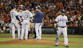 Tampa Bay Rays relief pitcher Xavier Cedeno, right, walks off the field after being relieved after Baltimore Orioles' Chris Davis singled in the ninth inning of a baseball game, Friday, May 29, 2015, in Baltimore. Baltimore won 2-1. (AP Photo/Patrick Semansky)