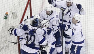 The Tampa Bay Lightning celebrate their 2-0 win over the New York Rangers in Game 7 of the Eastern Conference final during the NHL hockey Stanley Cup playoffs, Friday, May 29, 2015, in New York.  (AP Photo/Julie Jacobson)