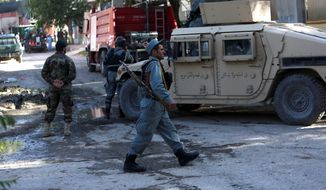 Afghan security officers patrolled near a guesthouse targeted by Taliban in an overnight attack in Kabul last week. An all-night siege in an upscale neighborhood of Afghanistan's capital ended in the early hours of Wednesday with the deaths of four heavily armed Taliban attackers, though no civilians or security personnel were injured or killed, an Afghan official said. (Associated Press)