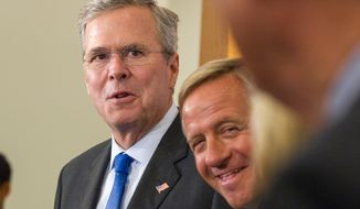 Former Florida Gov. Jeb Bush, left, and Tennessee Gov. Bill Haslam attend a press conference before a state Republican Party fundraising dinner in Nashville, Tenn., on Saturday, May 30, 2015. (AP Photo/Erik Schelzig)