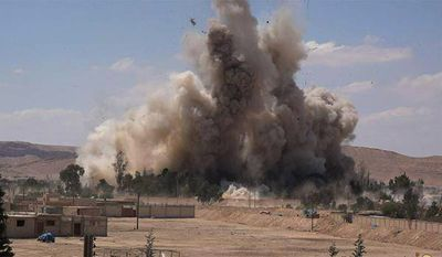 In this photo released on Saturday, May 30, 2015, by a militant website, which has been verified and is consistent with other AP reporting, smoke rises at Tadmur prison after being blown up and destroyed by the Islamic State group at Palmyra Town, in Homs province, Syria. (Militant website via AP)