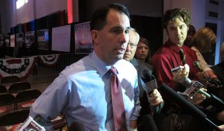 A Washington Times story about top Republicans such as Wisconsin Gov. Scott Walker skipping the Iowa straw poll triggered a move by Craig Williams, a member of the state party's central committee, to rally to save the poll. (Associated Press)