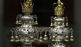Ceremonial bells belonging to the 250-year-old Touro Synagogue in Newport, R.I., and worth more than $7 million are seen on display at the Museum of Fine Arts in Boston, Monday, June 1, 2015. (AP Photo/Stephan Savoia)